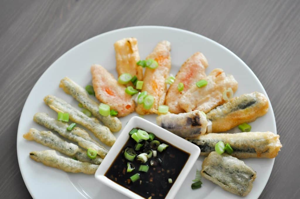 tempura covered vegetables on a white plate