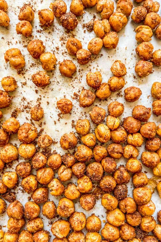 A closeup shot of spiced chickpeas on a sheet pan.