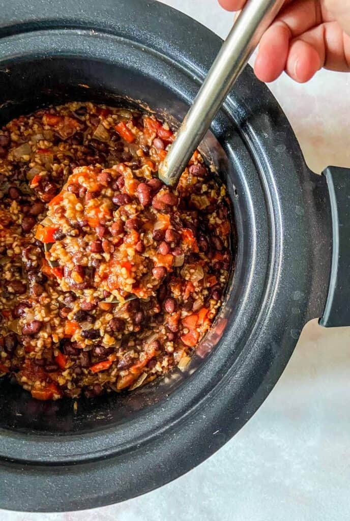 slow cooker chili in crockpot with ladle