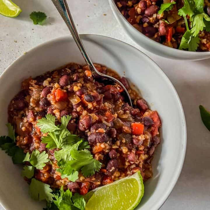 closeup of slow cooker black bean chili with a spoon