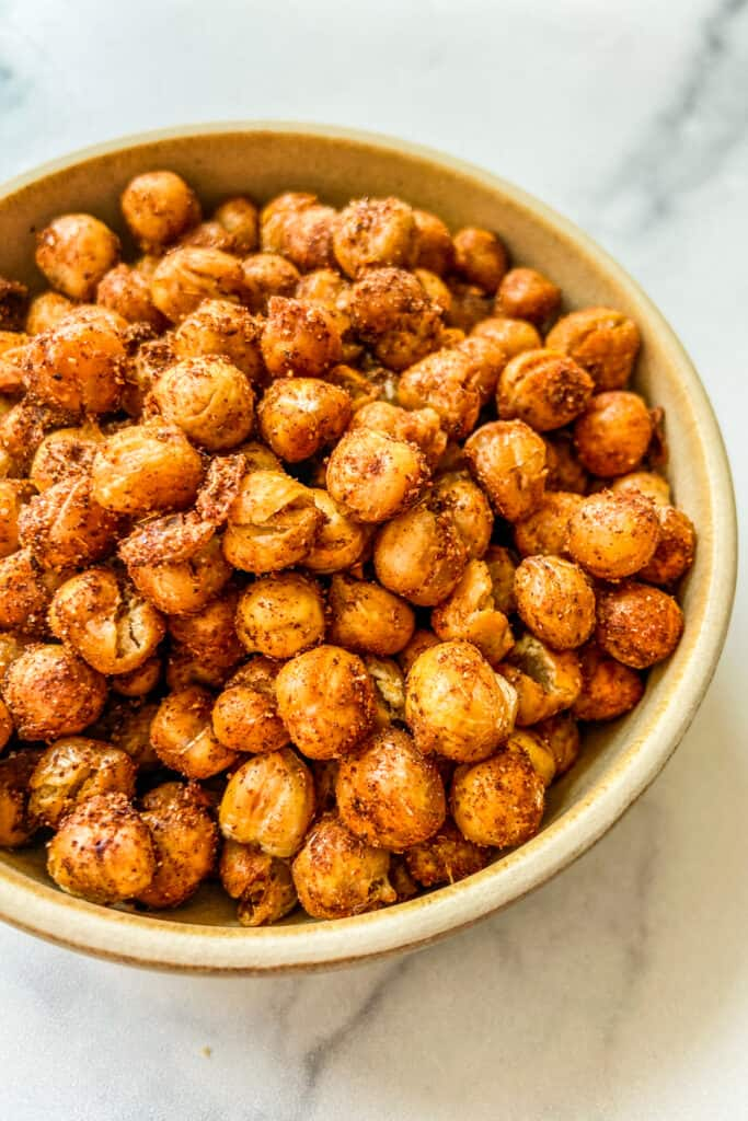 A closeup shot of a bowl of roasted chickpeas.