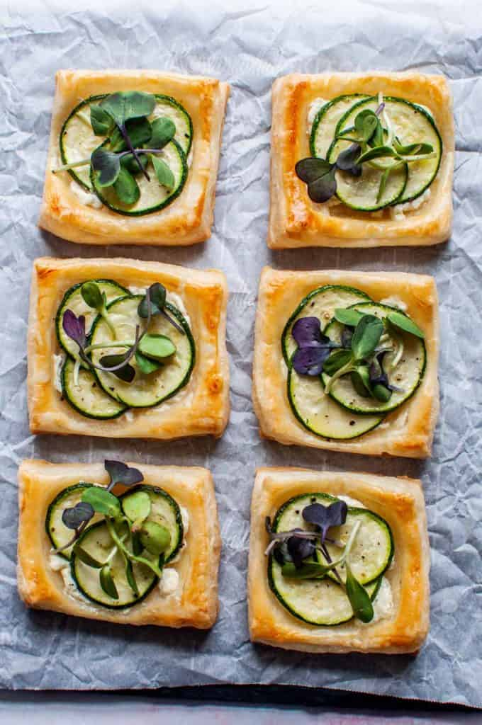 zucchini tartlets on a sheet of parchment paper