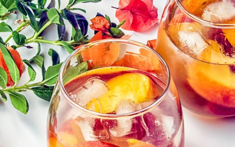 peach and raspberry sangria in wine glasses
