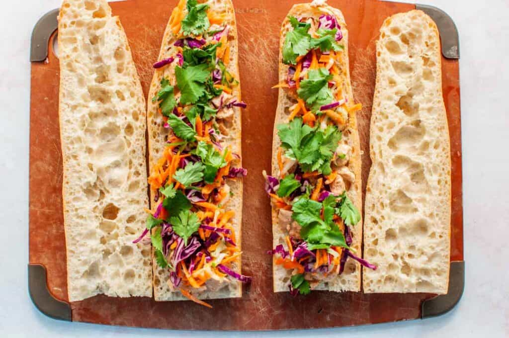 turkey banh mi sandwiches on a cutting board