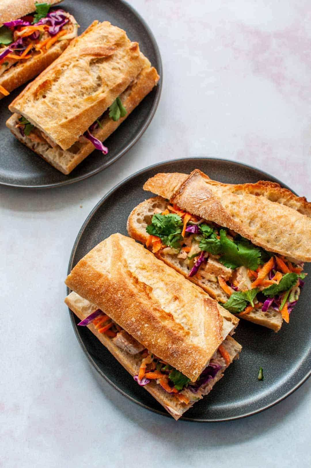 turkey banh mi sandwiches on a grey plate