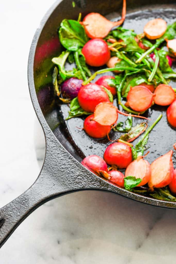 brown butter radishes in a cast iron skillet