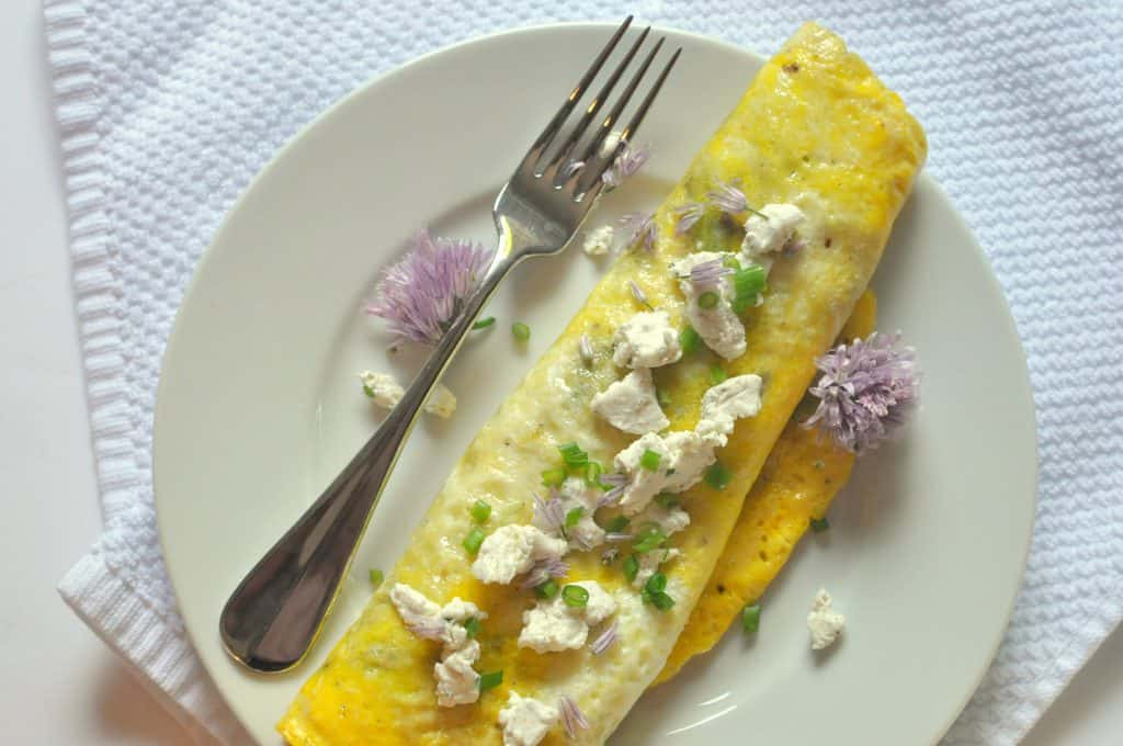spring omelette on a plate with a fork