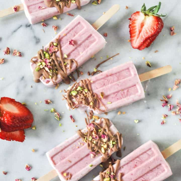 strawberry rose popsicles with a chocolate drizzle