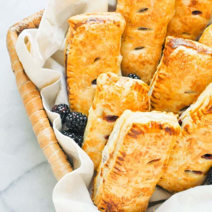 blackberry apple hand pies in a basket