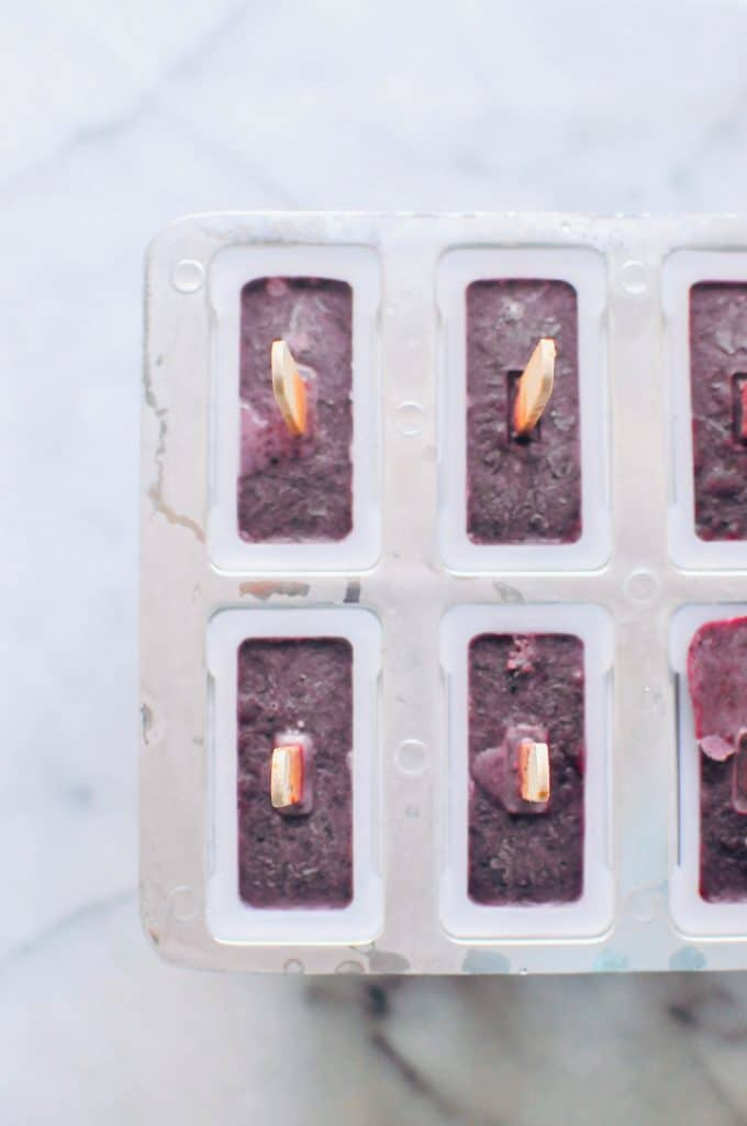 blueberry basil popsicles in a popsicle mold