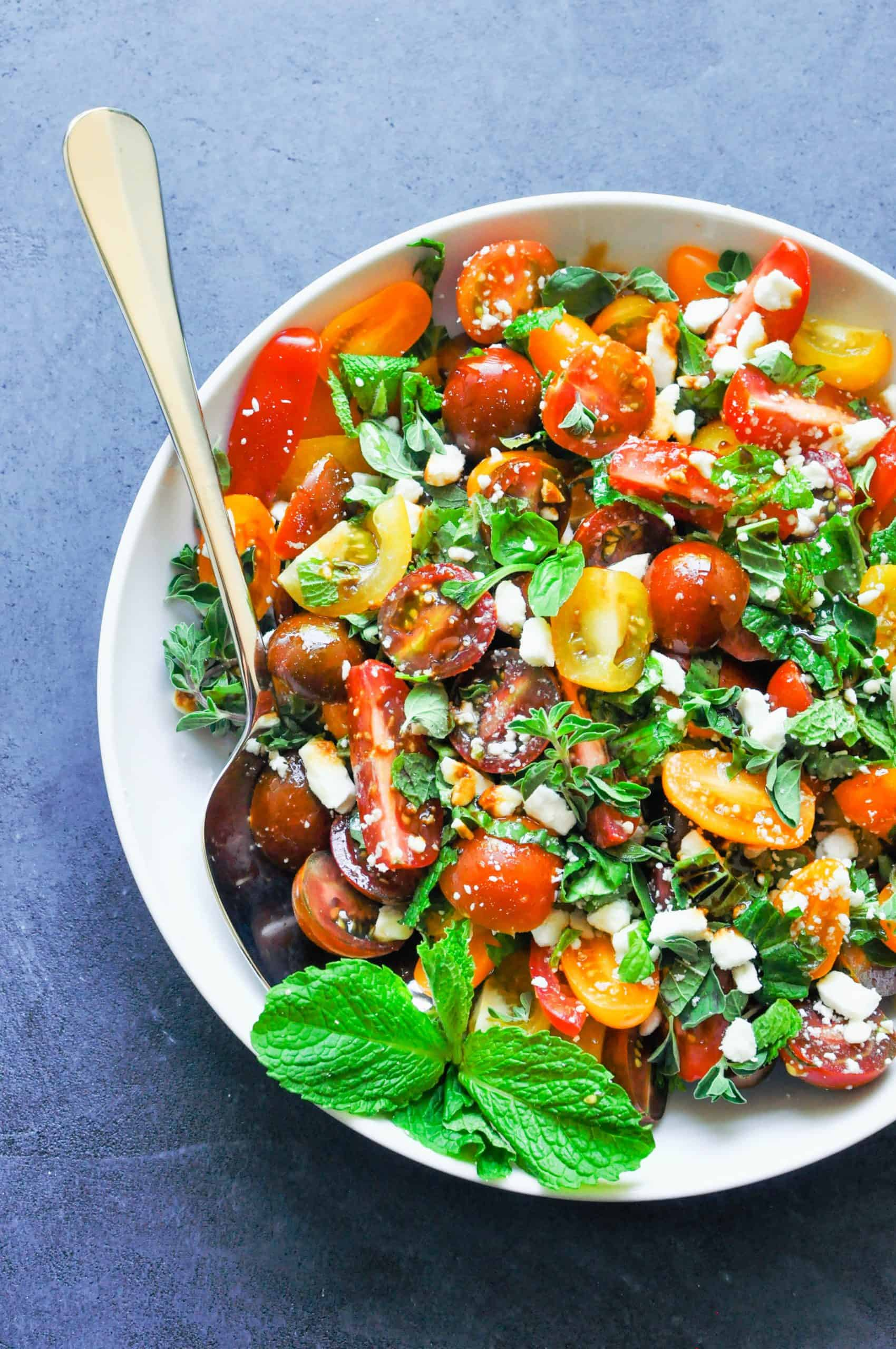 tomato and herb salad in a large serving bowl