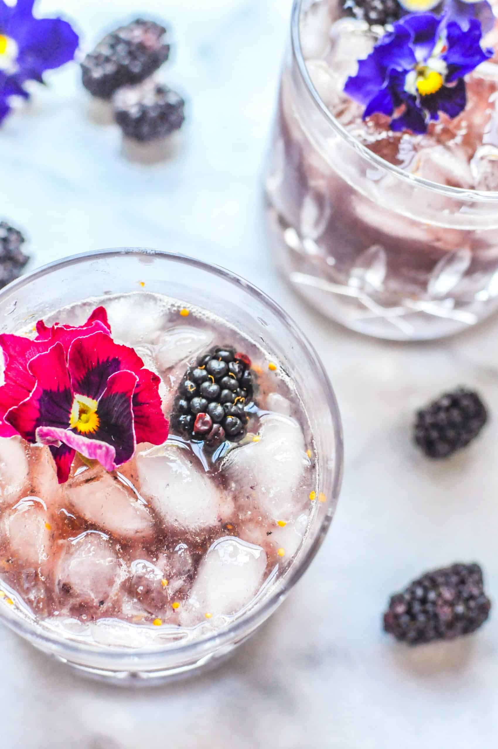 smash cocktail in a glass with blackberries