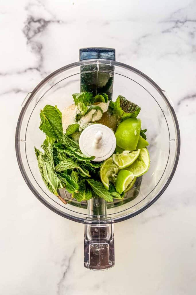 Limes, mint, sugar, and lime juice in a small food processor.