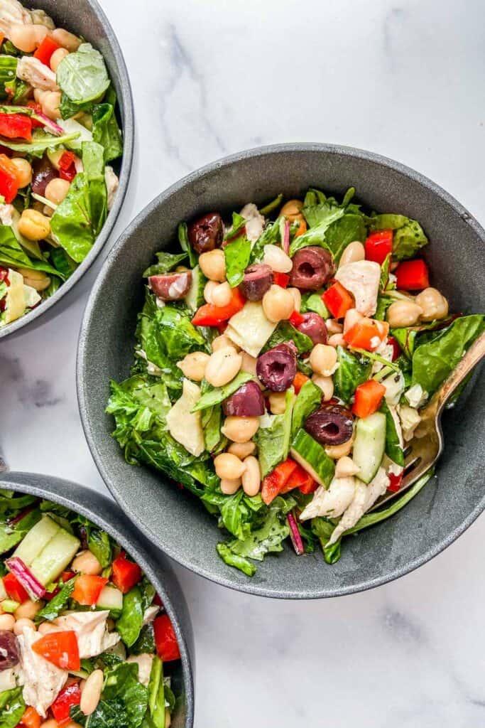 A closeup shot of a bowl of Mediterranean chicken salad.