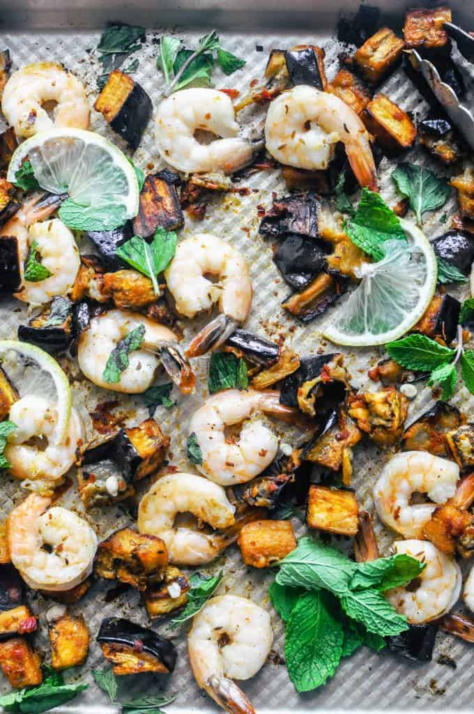 closeup of shrimp and eggplant on a baking sheet