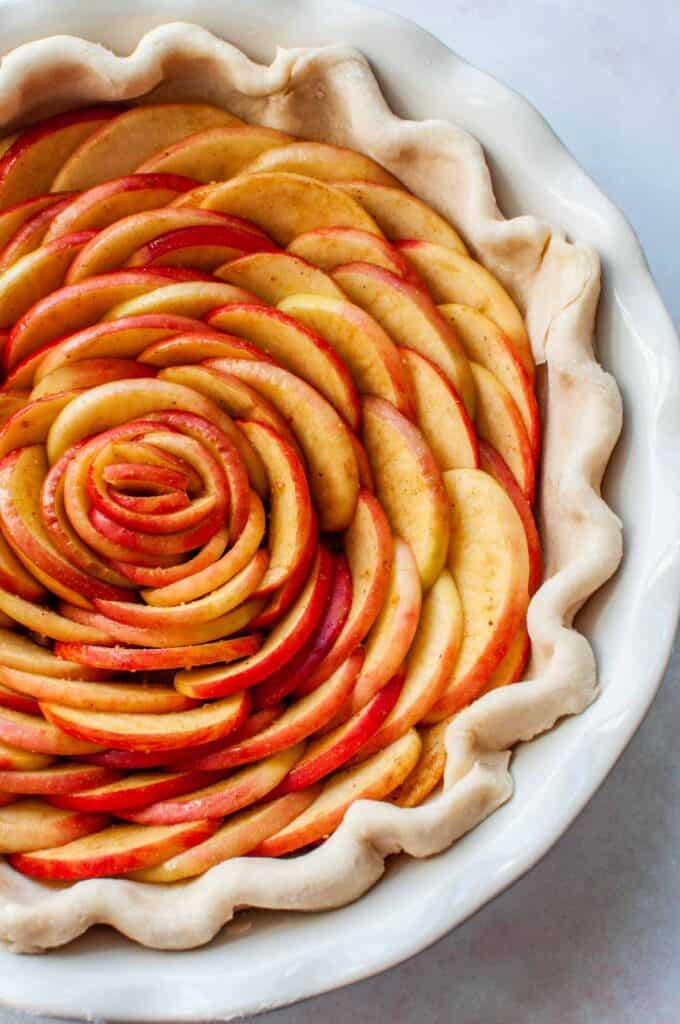 rose apple tart in a pie pan