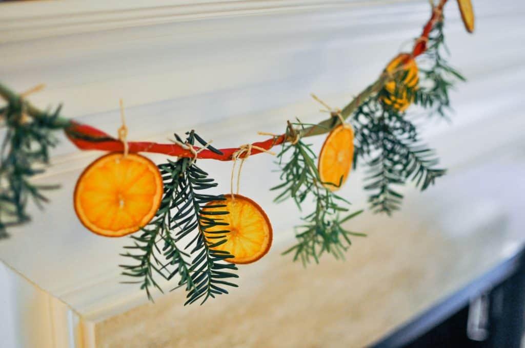 citrus garland hanging on mantle