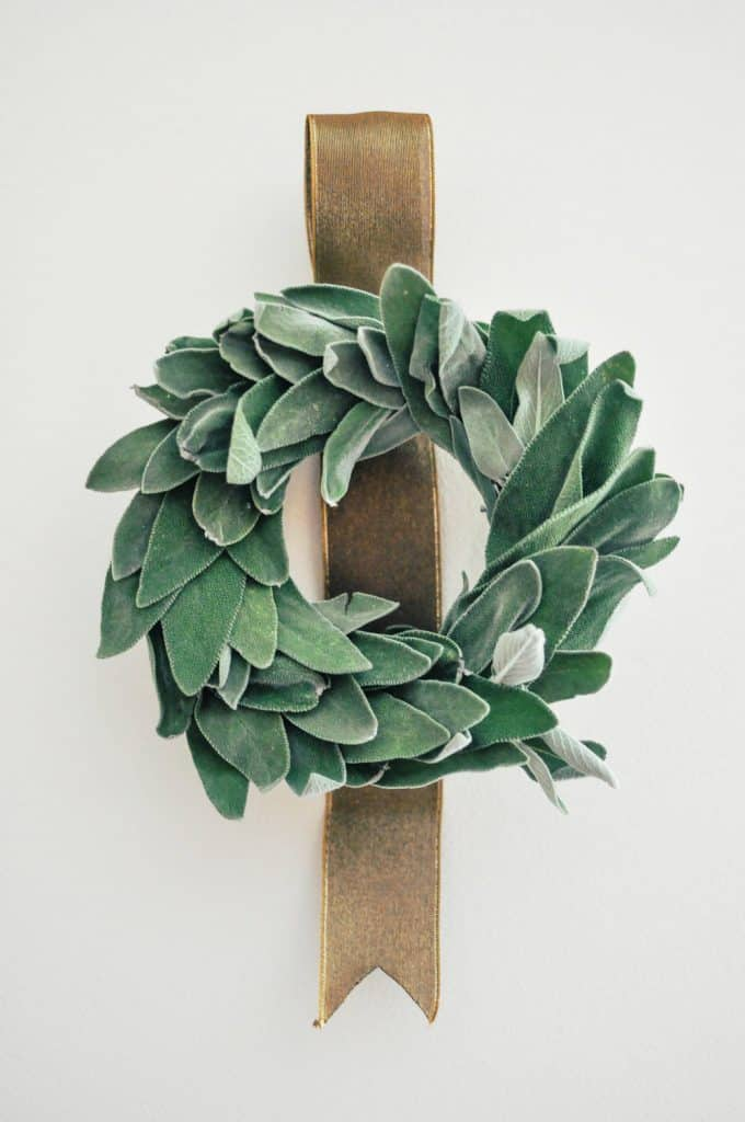 sage wreath with gold ribbon
