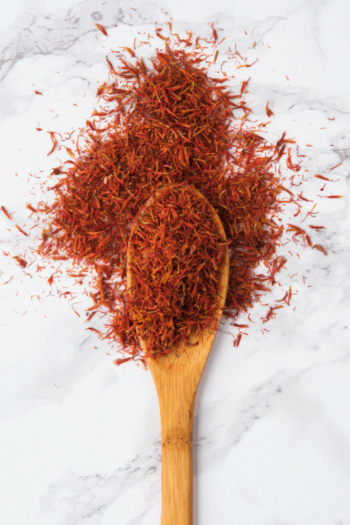 saffron strands on a wooden spoon