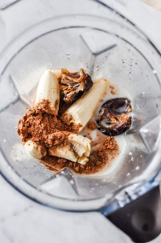 cacao, banana, and dates in a blender