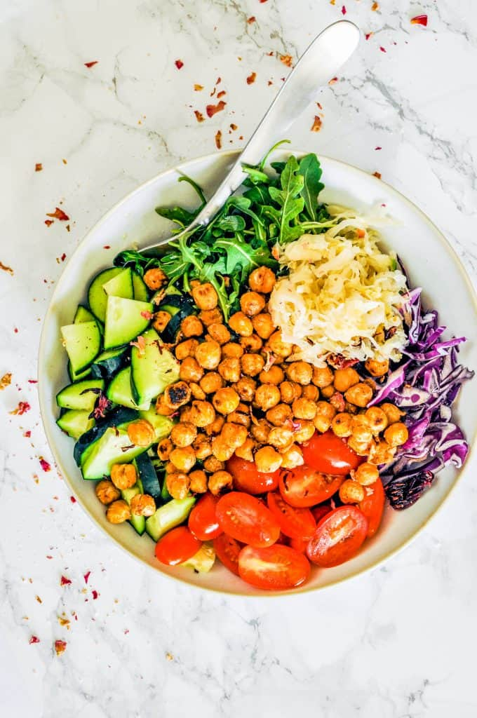 closeup of a bowl of roasted chickpeas and veggies