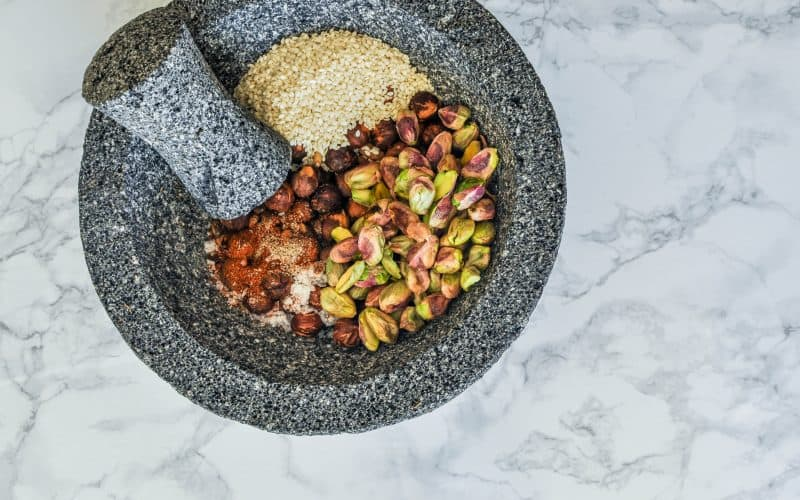 spices and nuts in a mortar and pestle