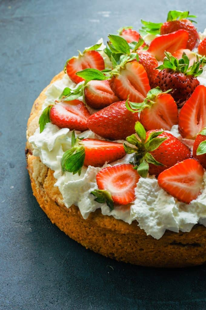 strawberry tahini shortcake topped with whipped cream and fresh berries