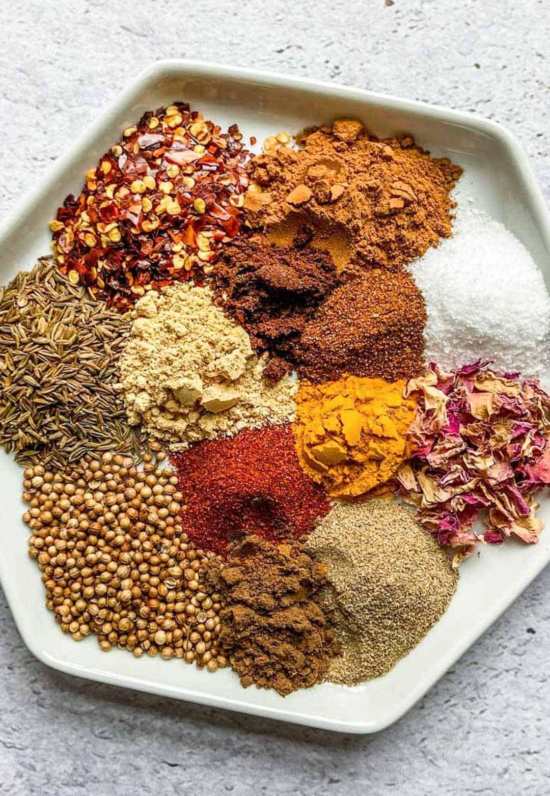 ras el hanout ingredients on a plate