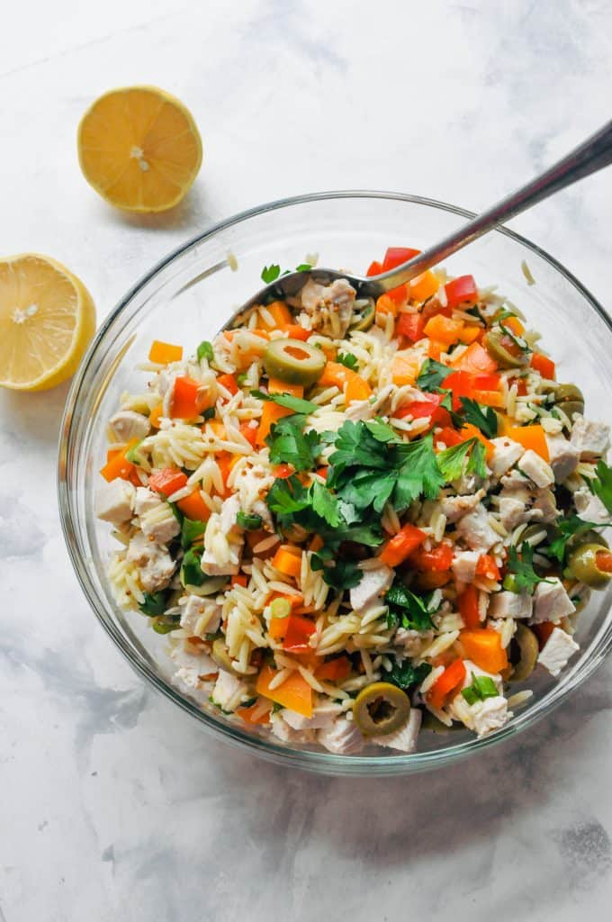 chicken orzo salad in a glass bowl