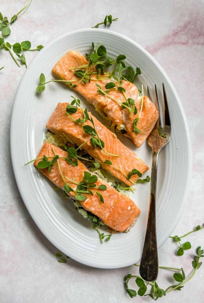 spinach stuffed salmon on a plate