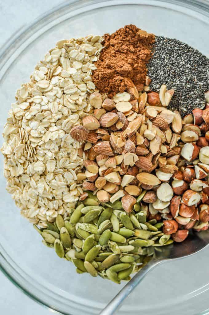 granola ingredients - oats, nuts, spices, chia seeds