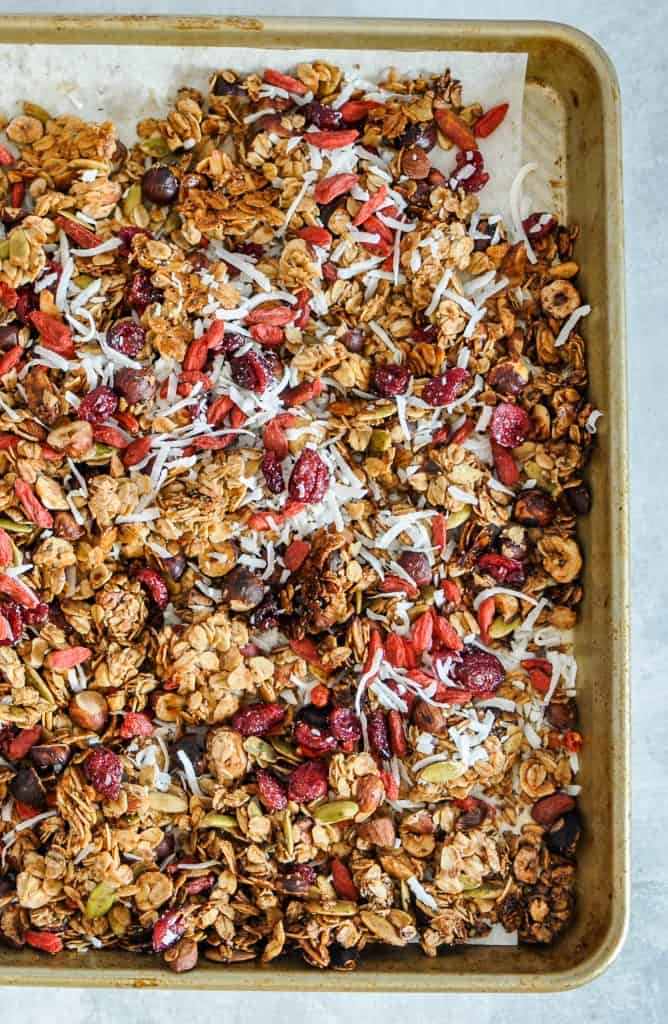 baked granola with coconut, goji berries, and cranberries