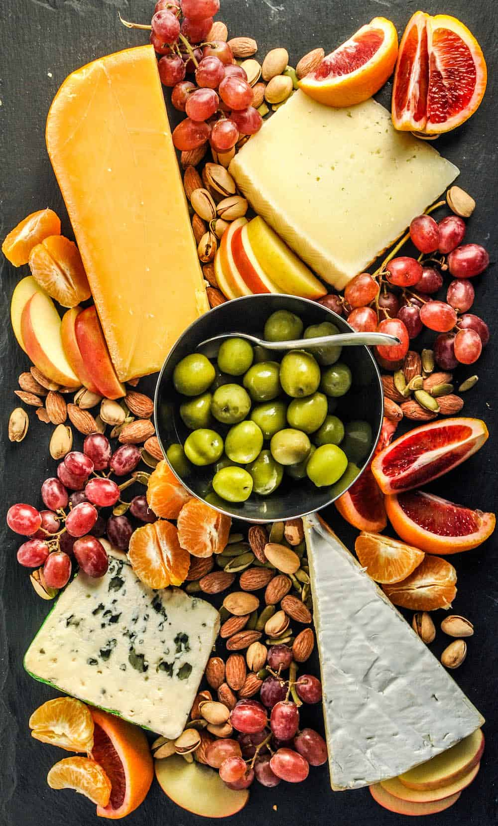 appetizer tray with cheese, nuts, and fruit