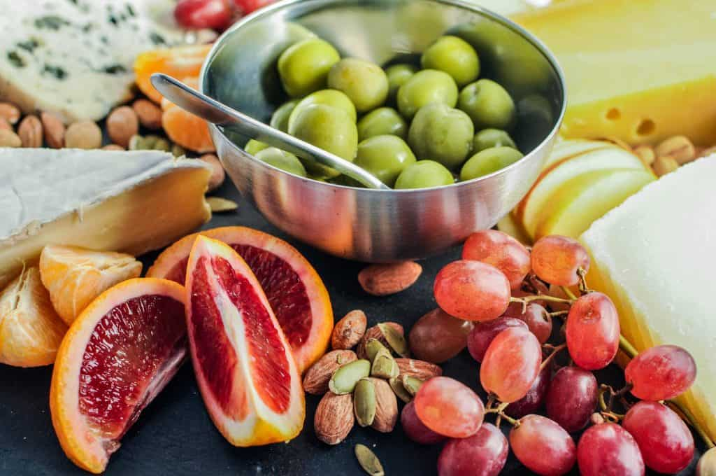 closeup of blood oranges and green olives