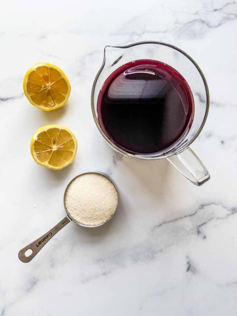 Pomegranate molasses ingredients - pomegranate juice, lemon, and sugar.