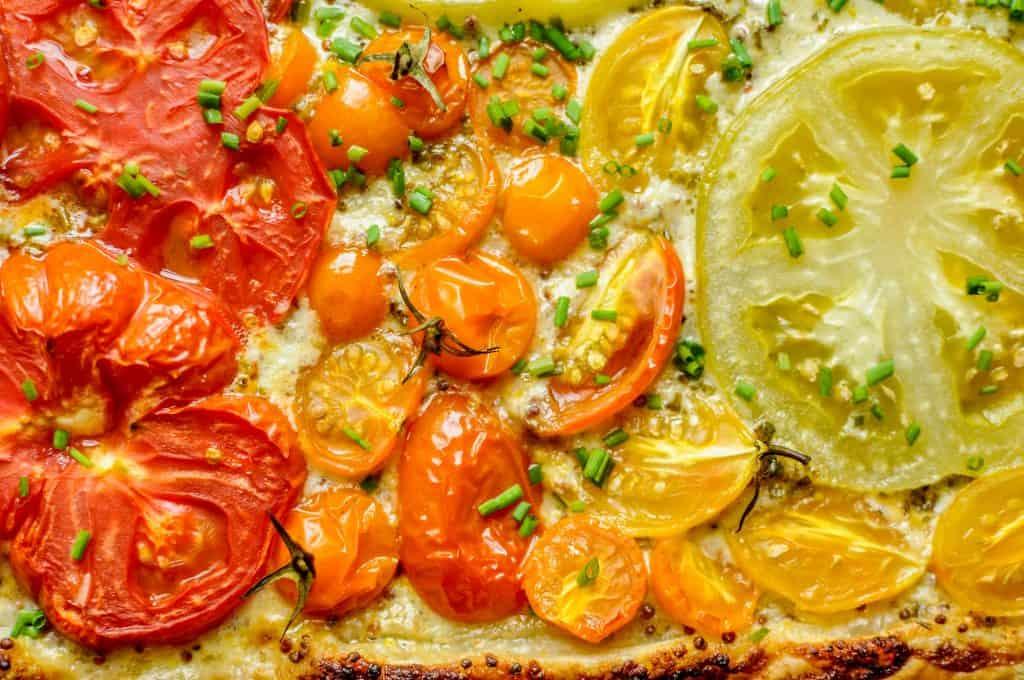 closeup of tomatoes on tart