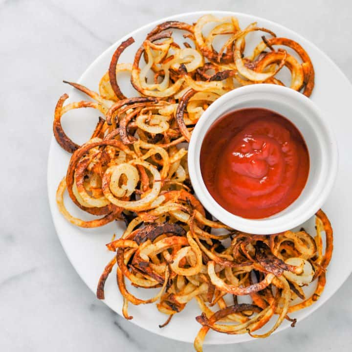 baked curly fries with ketchup