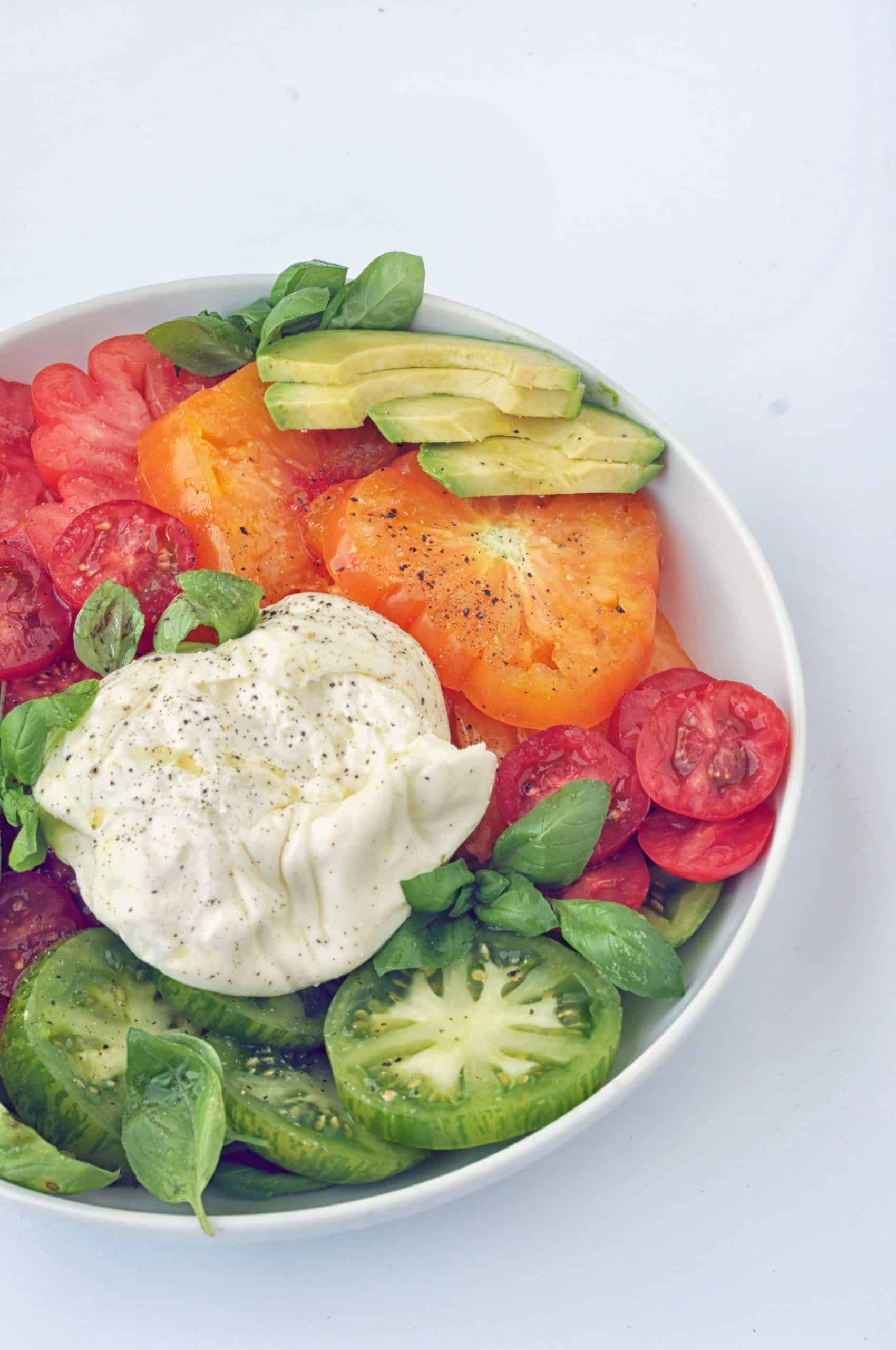 burrata caprese salad recipe on a plate
