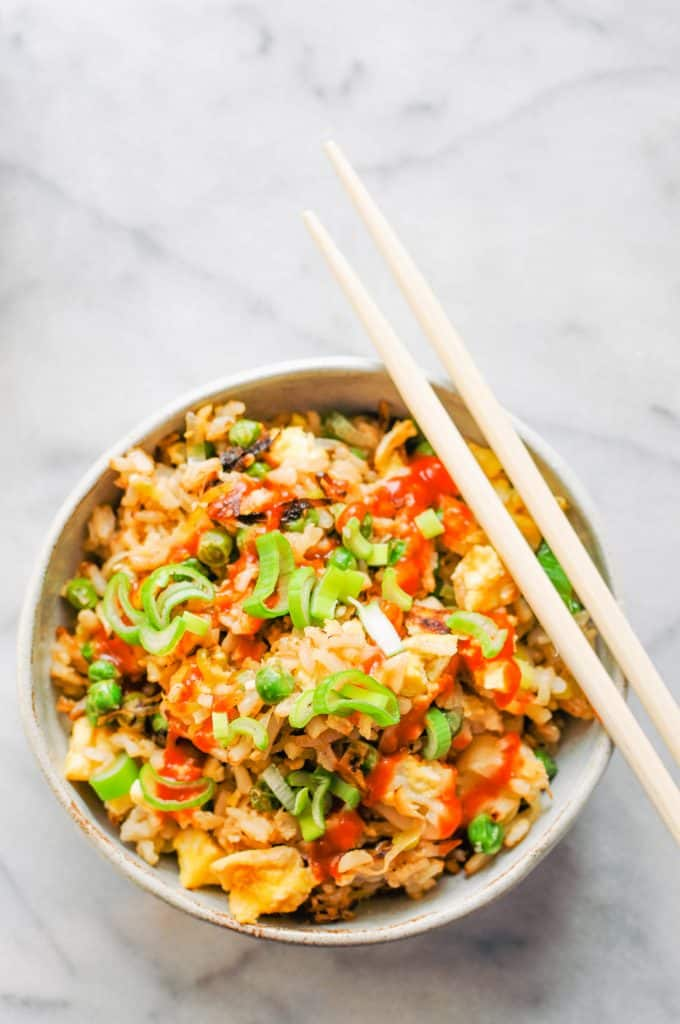 leek and pea fried rice in a bowl with chopsticks
