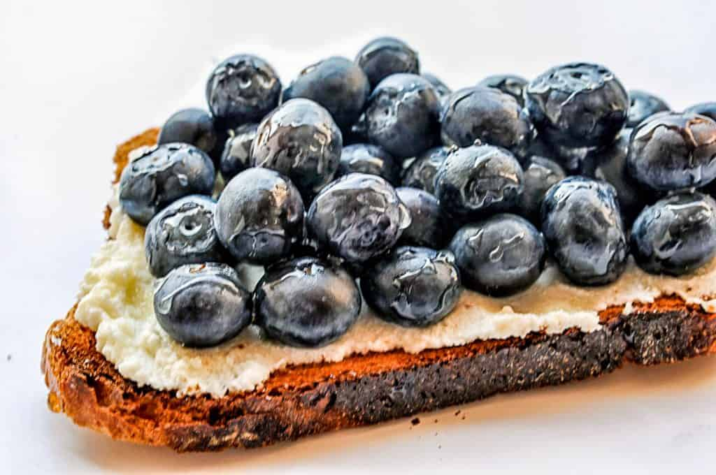 blueberry ricotta toast on a white background