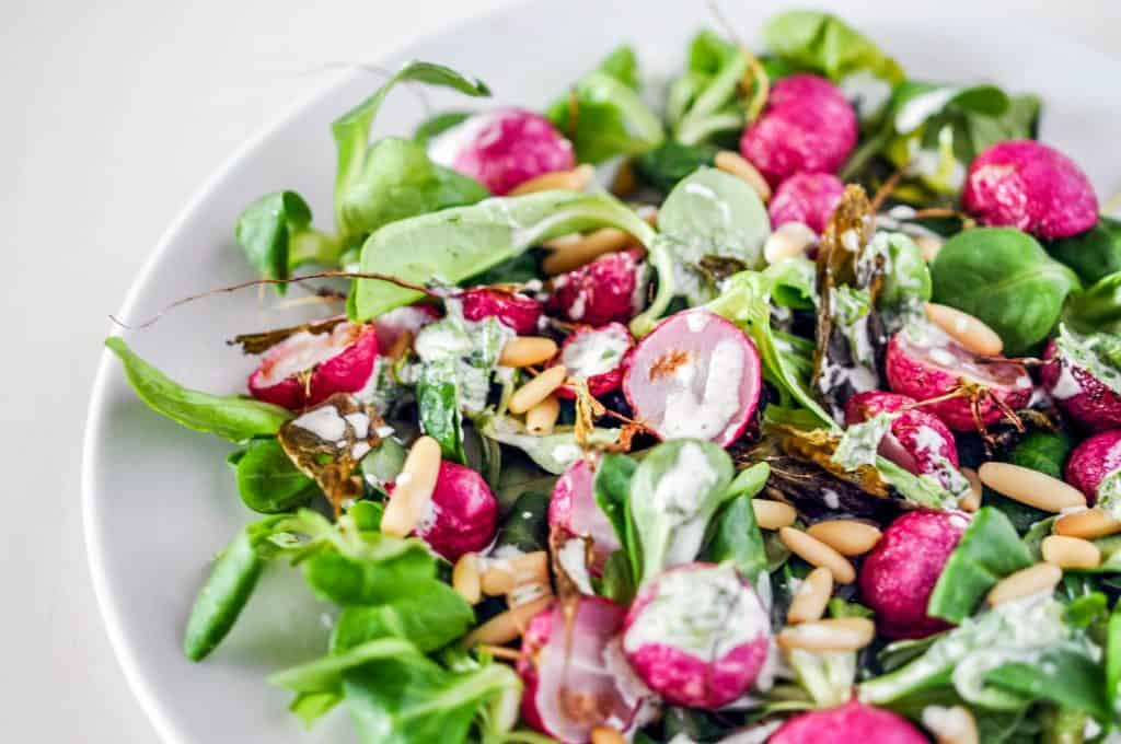 roasted radish salad with a creamy dressing on a plate