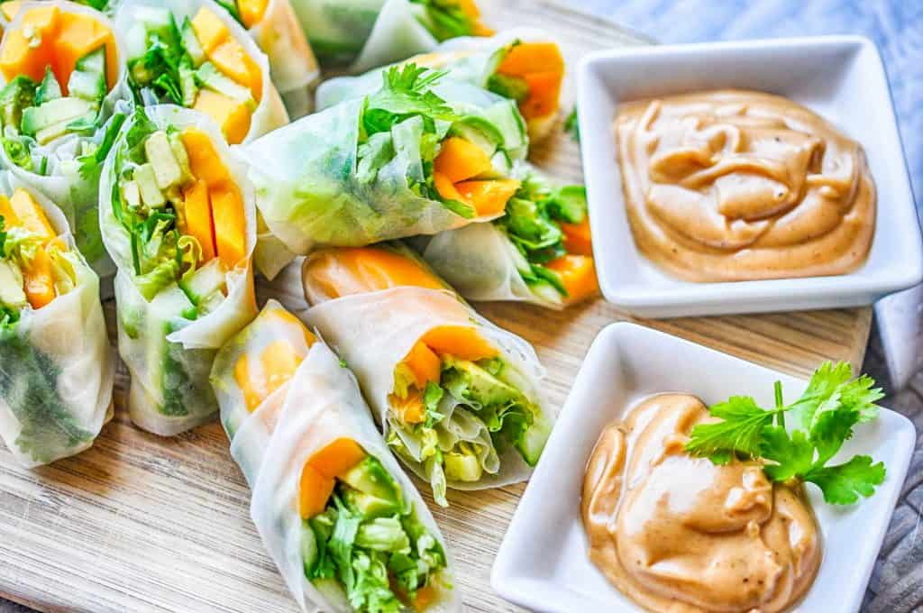 tropical vegan summer rolls with a peanut dipping sauce