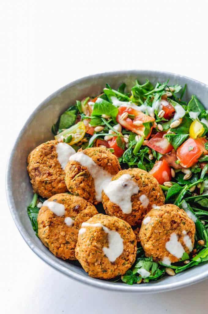 baked falafels and salad in a bowl