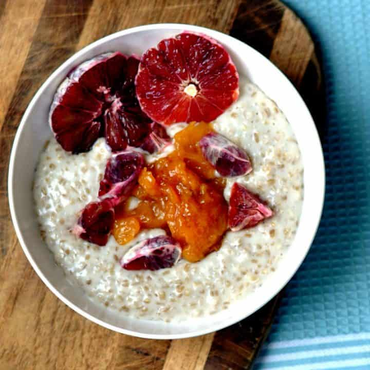 steel cut oats in a bowl with blood oranges and peach compote topping