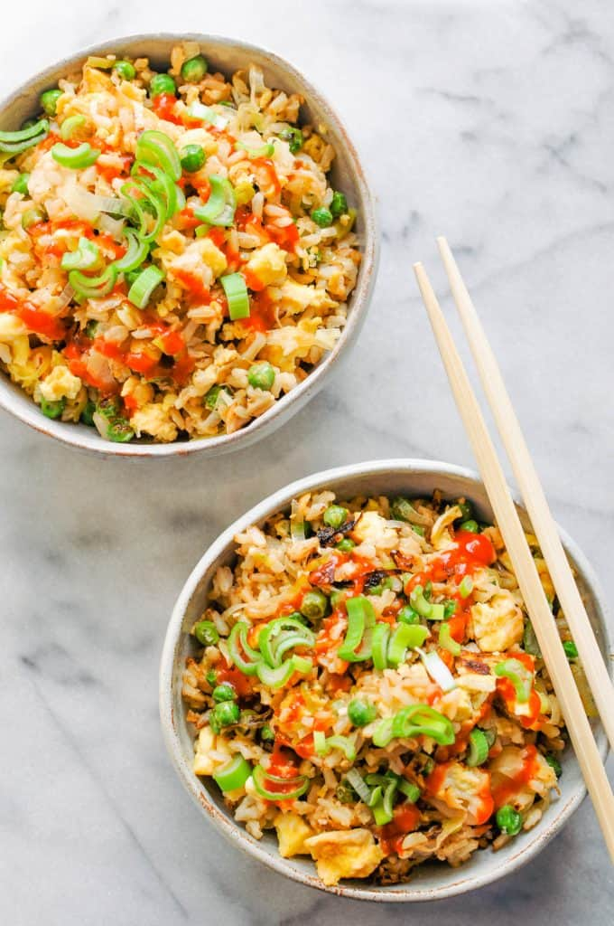 two bowls of leek and pea fried rice