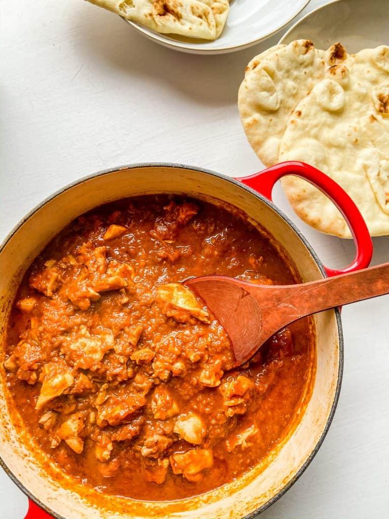 berbere spiced chicken in a pot