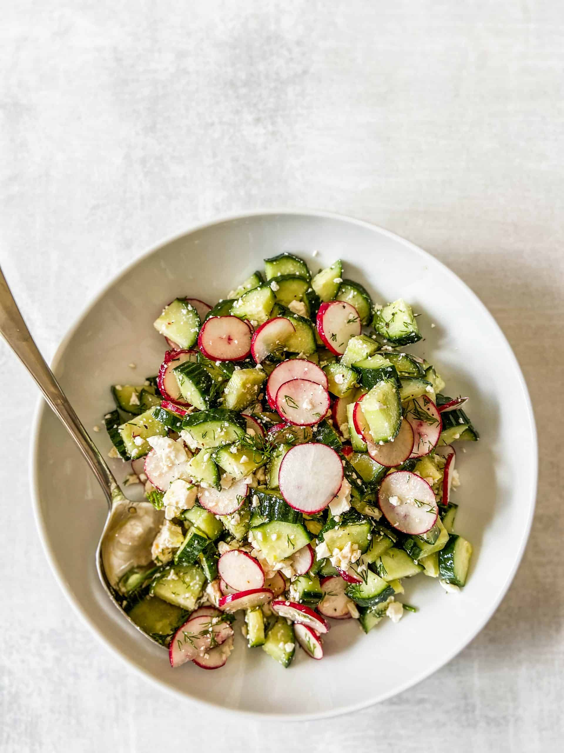 overhead shot of radish cucumber salad in a bowl