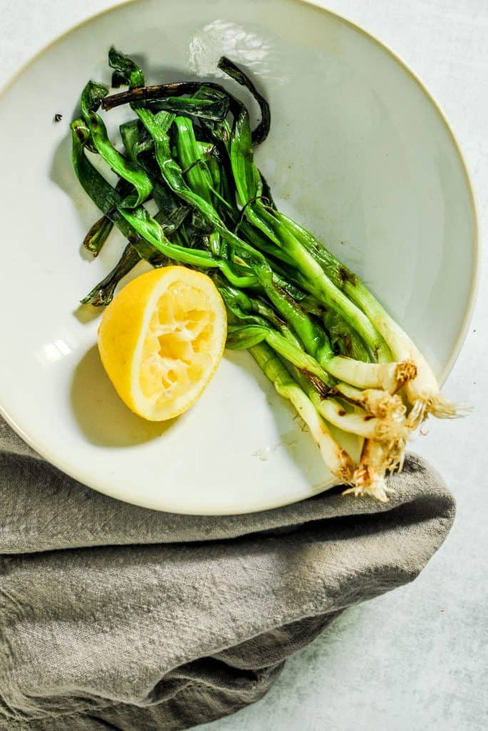 grilled scallions in a bowl