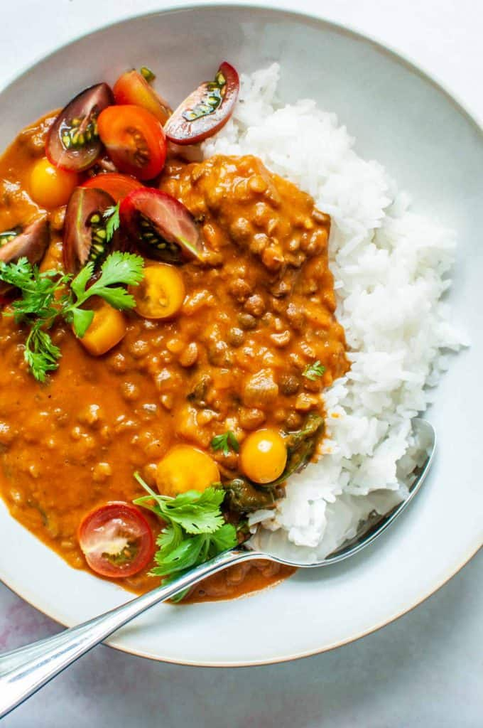 coconut lentil curry with white rice in a bowl