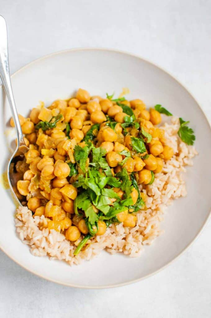 chickpea curry with brown rice in a bowl